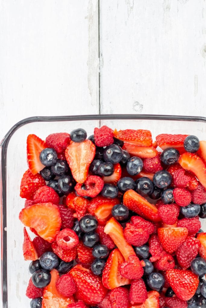 fruit in a glass pan on a white background with space