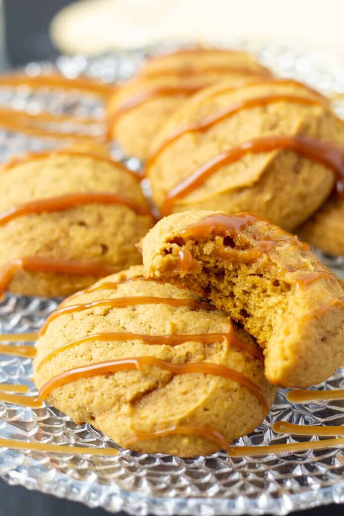 pumpkin cookies with caramel drizzled over the top.