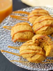 pumpkin cookies drizzled with caramel on a plate