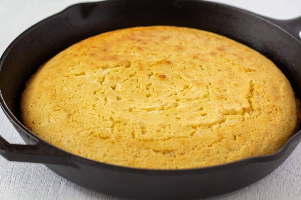 Cast-iron Skillet Cornbread in a pan on a white background