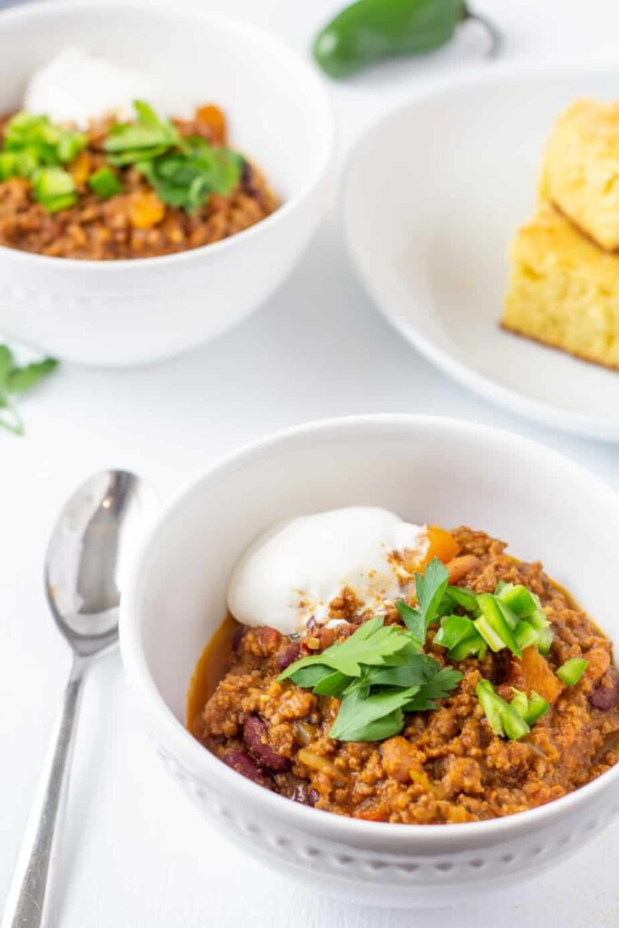 chili in a white bowl with a spoon