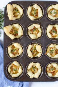 cooked pastry puffs with filling in a muffin sheet