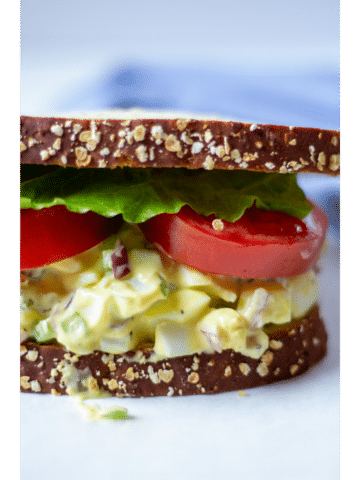 egg salad sandwich on a white background