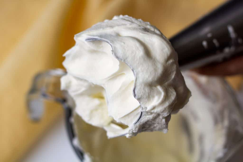 whipped cream on the end of a hand blender