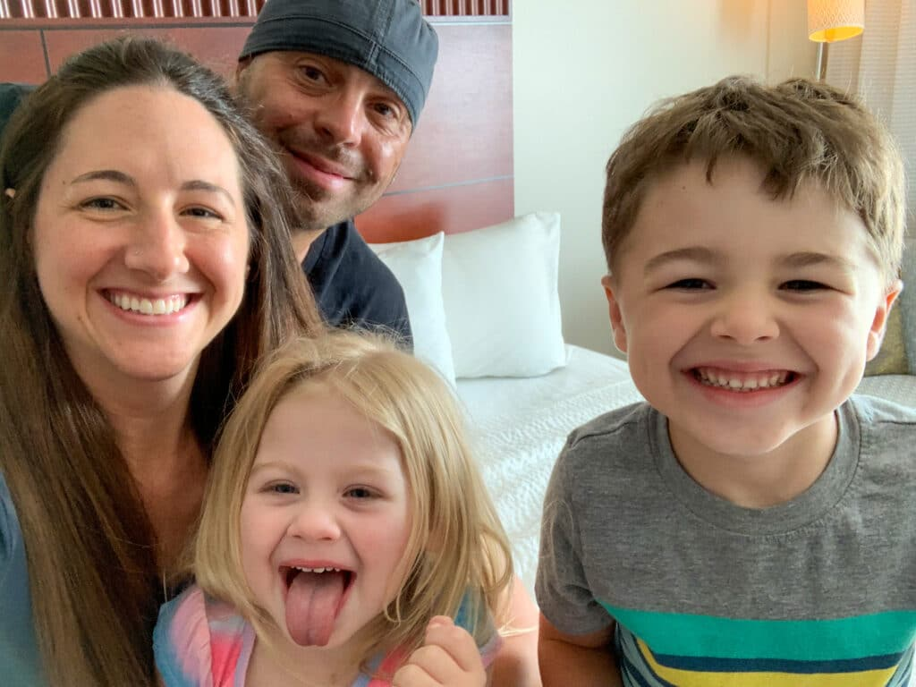 a family in a hotel room