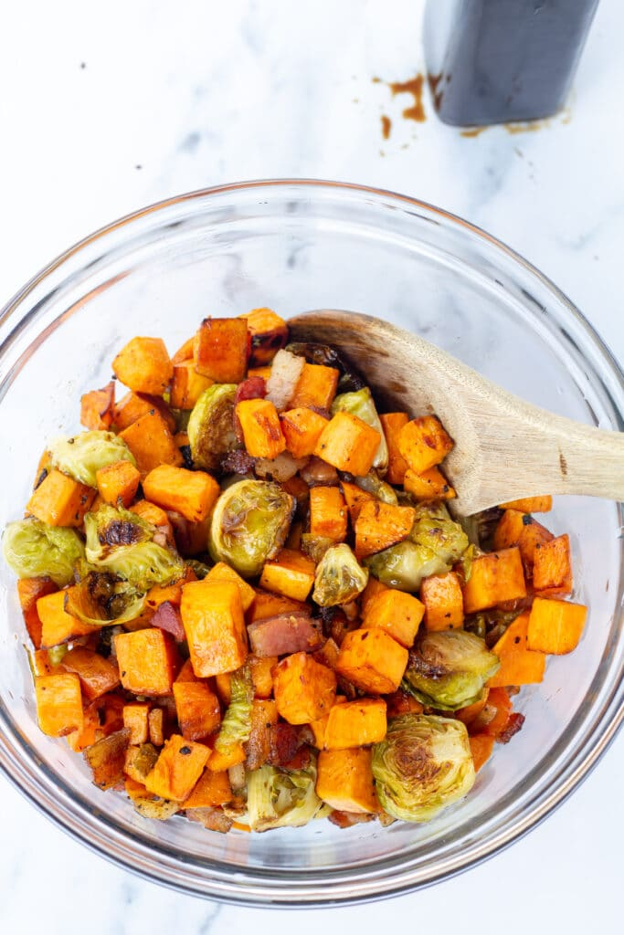Colorful mix of brussel sprouts and sweet potatoes on a bright white background