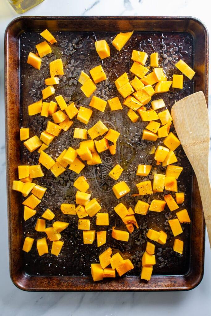 Butternut squash on a weathered baking sheet