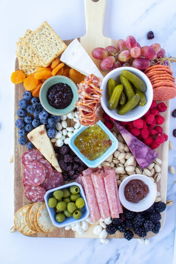 a close up of a filled charcuterie board
