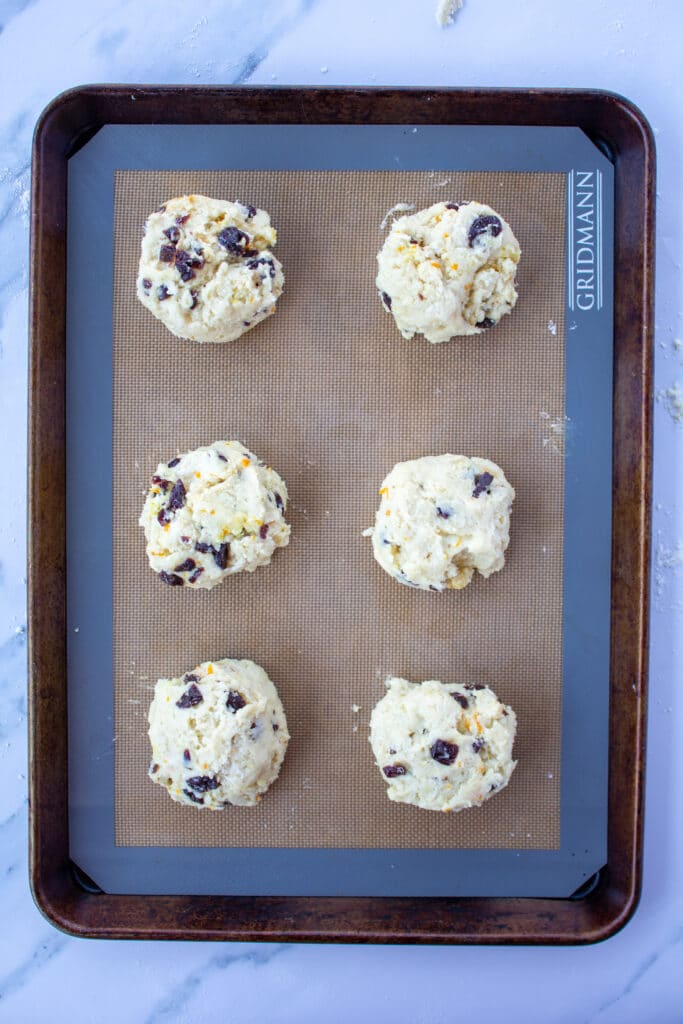 biscuit shaped scones on a baking sheet zoomed out