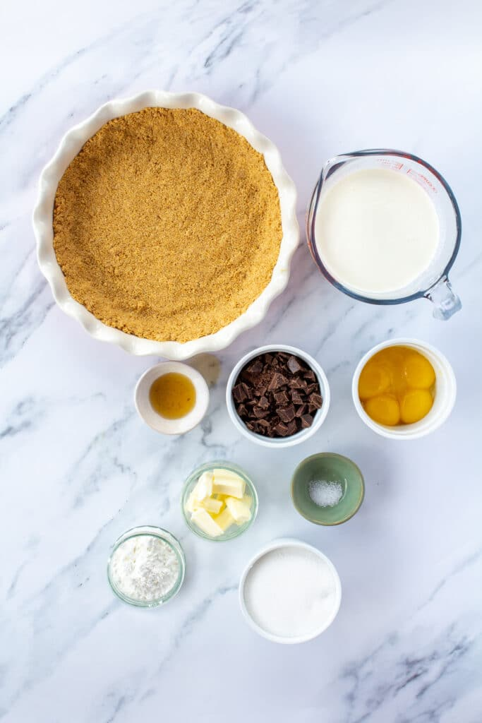 pie ingredients on a white marble background