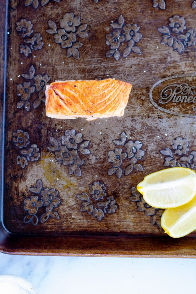 One piece of salmon on a baking sheet