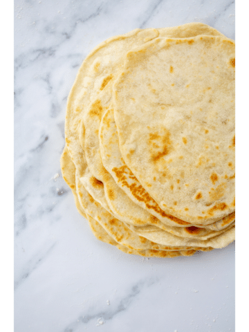 stack of tortillas on a marble background