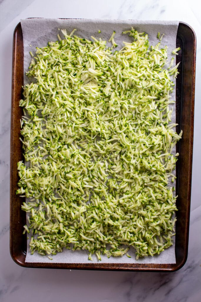 shredded zucchini on a baking sheet
