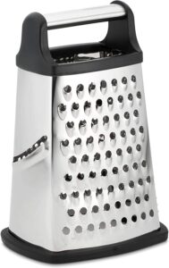 A silver box grater with a black and silver handle on top