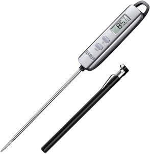 a digital kitchen thermometer with a case for the needle next to it
