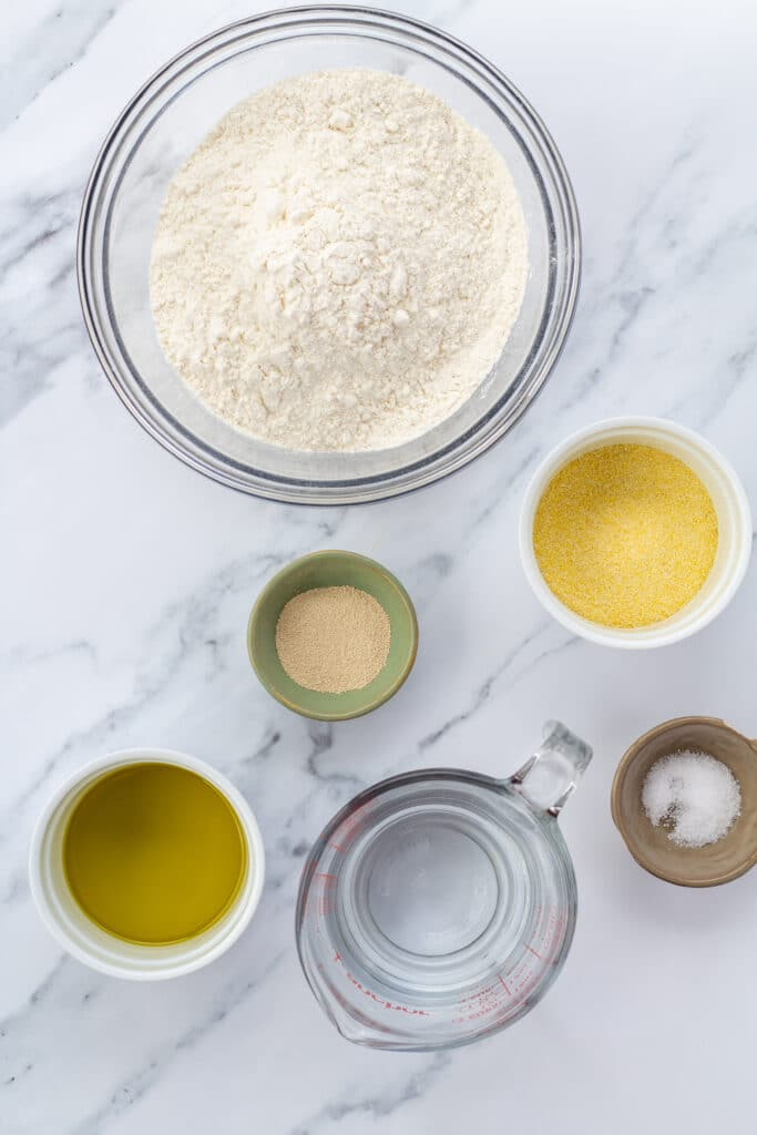 pizza dough ingredients on a marble counter
