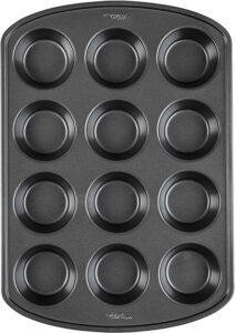 A dark gray muffin pan