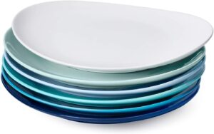 A stack of blue based plates with white on top