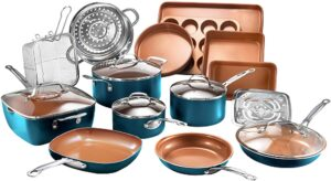 A large set of cook and bakeware arranged artfully