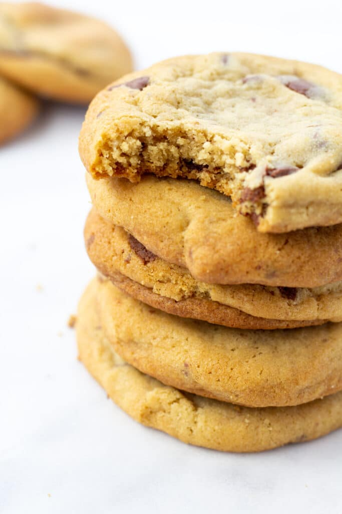 stack of fluffy cookies with top cookie bitten