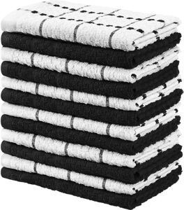 A stack of folded white and black kitchen towels