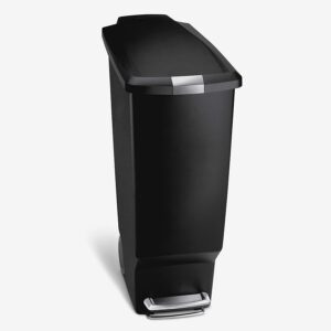 a black trashcan with a lid that raises by stepping on a device at the bottom