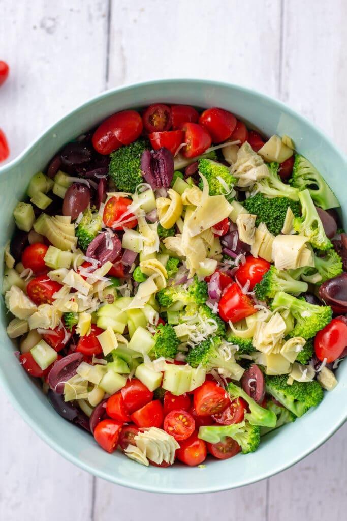 blue bowl of chopped veggies